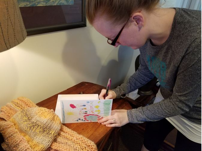 Signing cards for Turpin Cares winter care packages